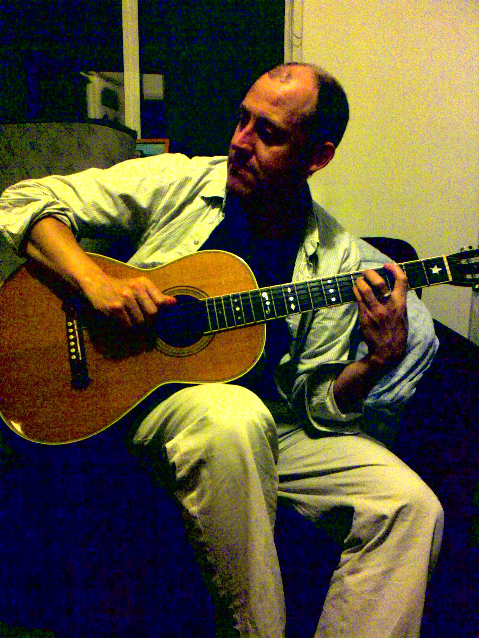 Dean plays acoustic guitar